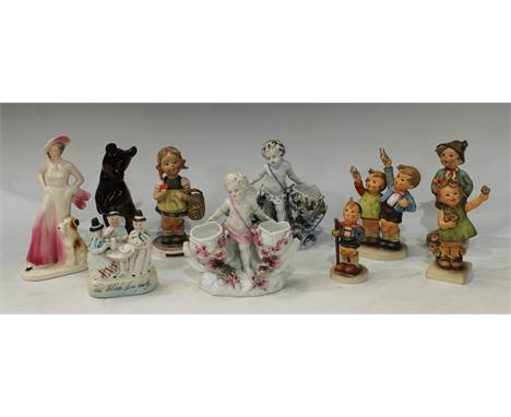 A pair of Sitzendorf figural table salts, putto; a Russian model bear; Goebel Hummel figures; an Art Deco figure (10)