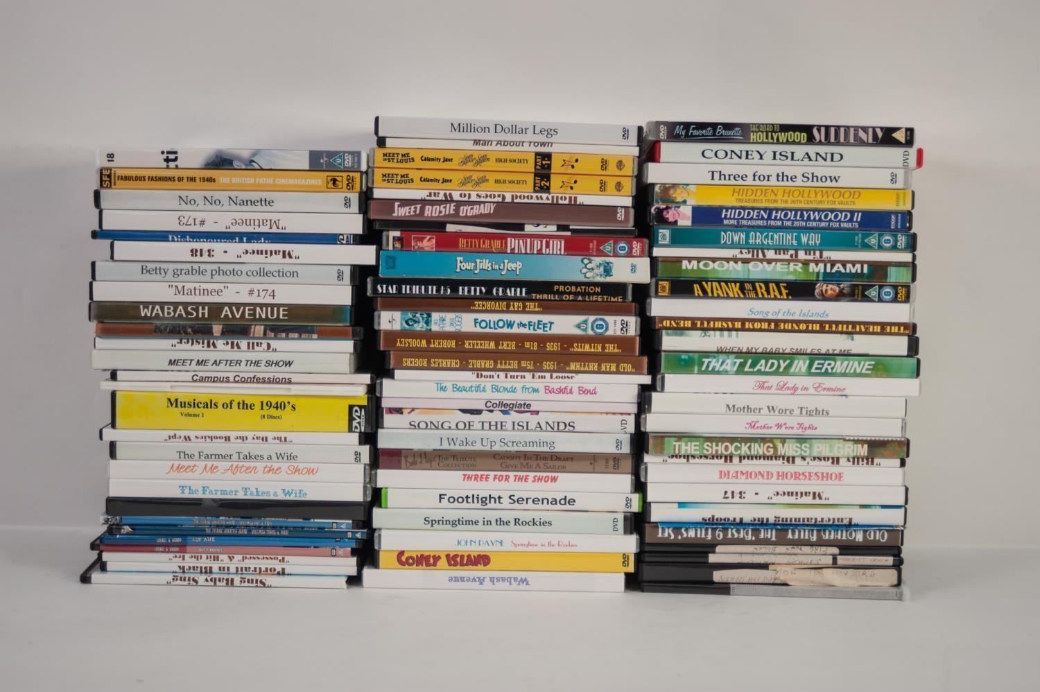 Lot 239 - OVER 200 DVDs, MOSTLY COPIES, MAINLY BETTY GRABLE including 'Three for the Show'; 'Hotspot', 'Song