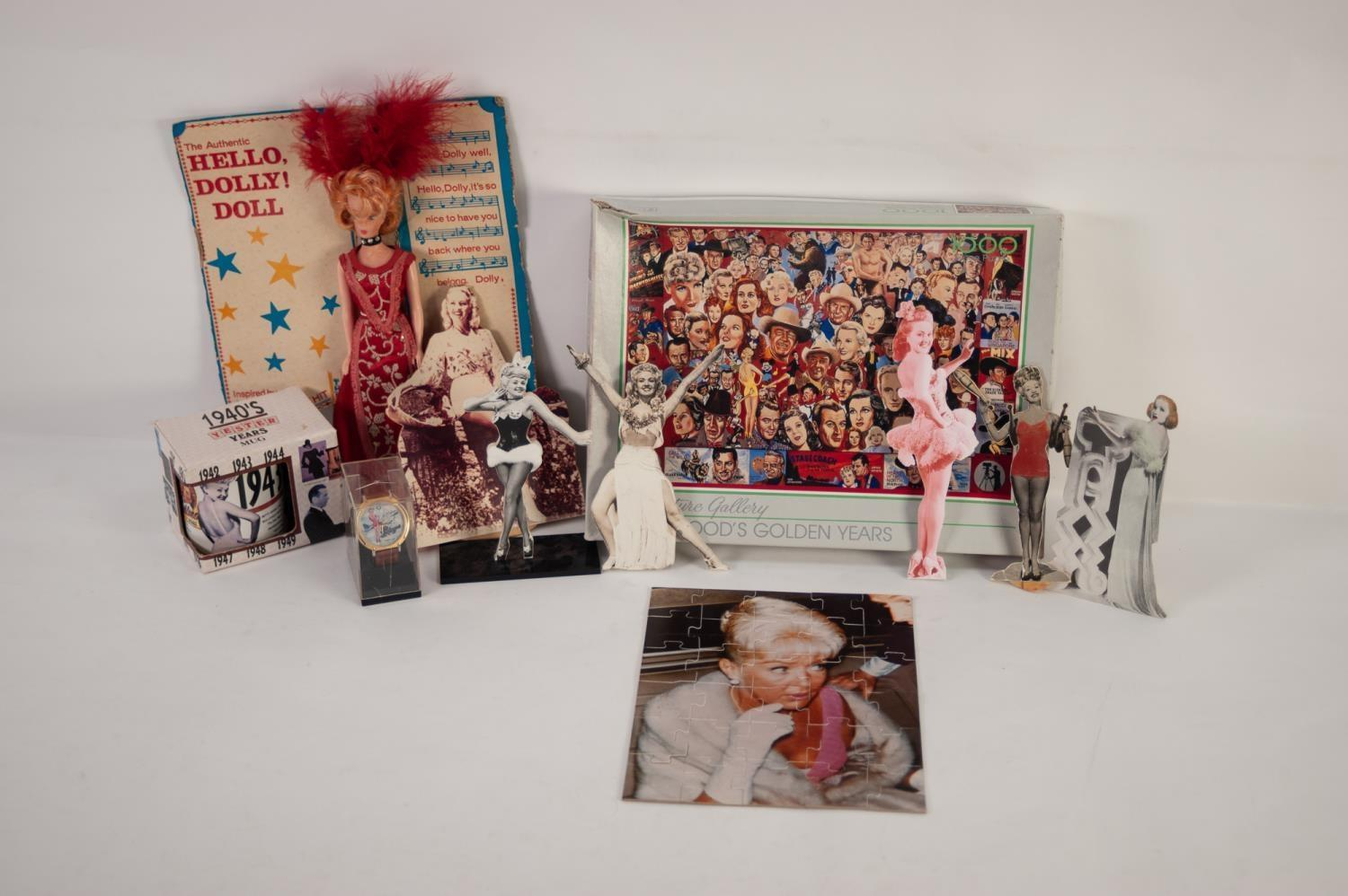 Lot 237 - FIVE BETTY GRABLE PHOTOGRAPHIC CUT-OUT SILHOUETTES and another, a Betty Grable JIGSAW; an 'Abbelare'