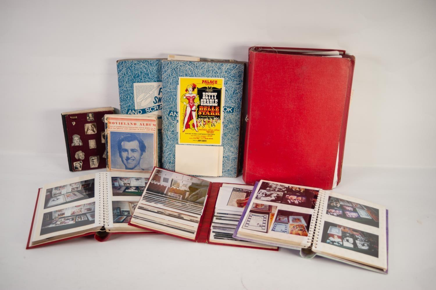 Lot 238 - SMALL ALBUM OF BETTY GRABLE SCRAPS annotated to the relevant films, etc., and EIGHTEEN OTHER RELATED