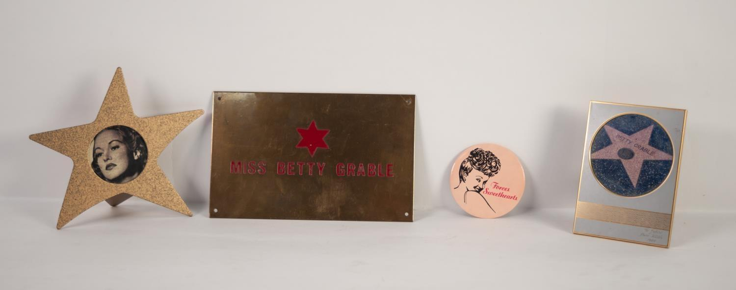 "Lot 236 - 'BETTY GRABLE' BRASS DRESSING ROOM NAME PLATE, 5"" x 8"" (12.7 x 20.3cm) and three related items (4)"