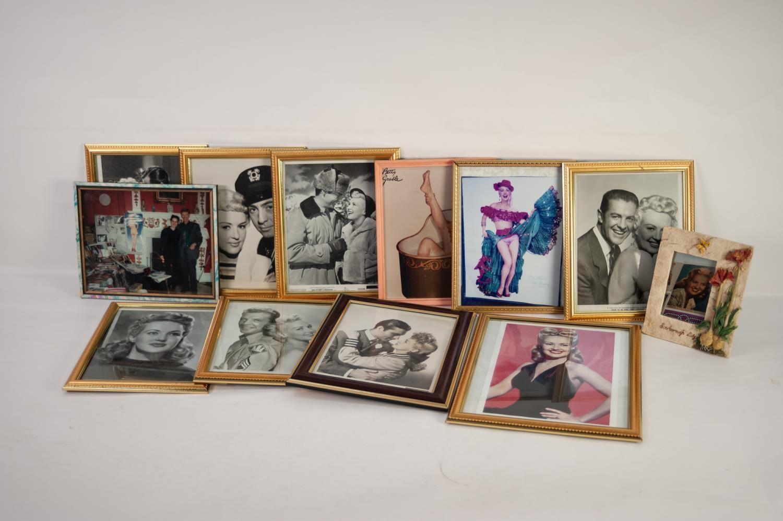 Lot 240 - FIFTEEN FRAMED LOBBY STILLS relating to Betty Grable films and TWELVE FRAMED PHOTOGRAPHS (27)