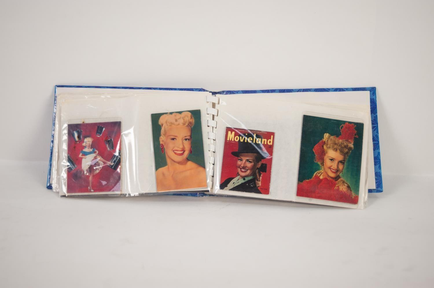 Lot 255 - ALBUM CONTAINING A COLLECTION OF 42 BETTY GRABLE FRIDGE MAGNETS