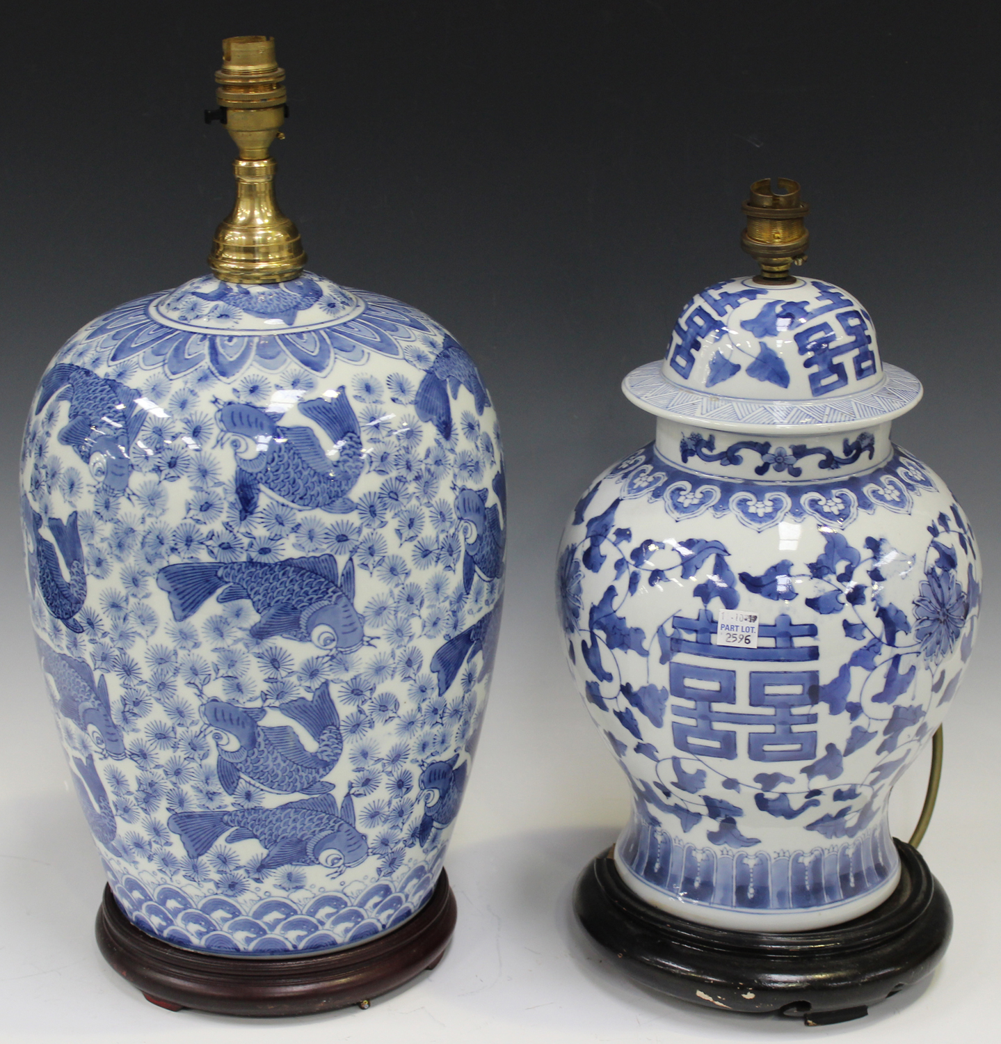 Lot 2596 - A modern Chinese blue and white transfer printed porcelain table lamp, decorated with overall