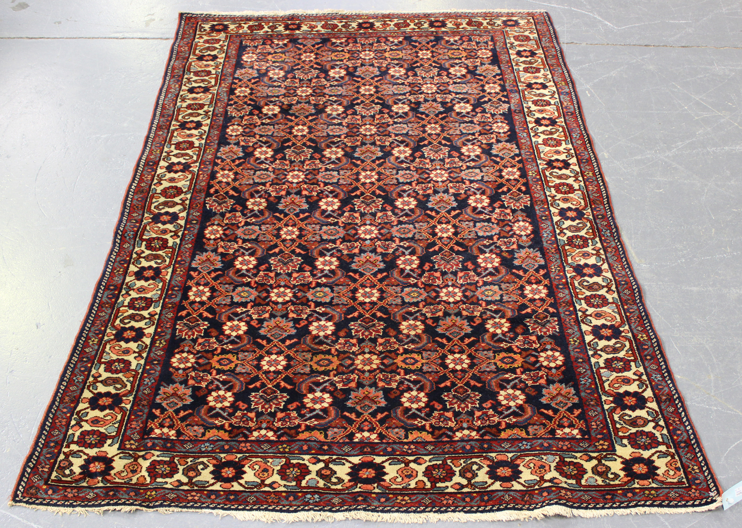 A Senneh rug, North-west Persia, early/mid-20th century, the ink blue field with an overall floral