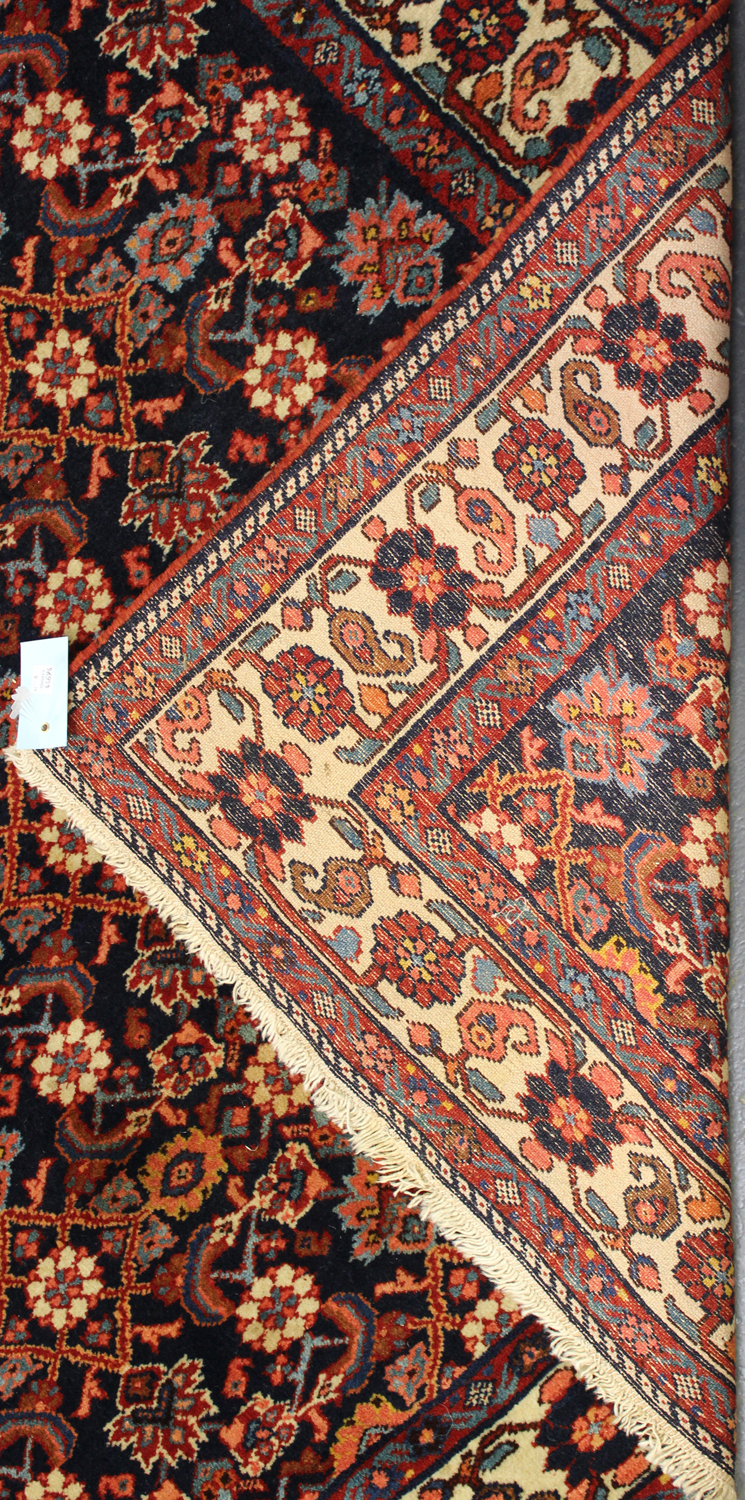 A Senneh rug, North-west Persia, early/mid-20th century, the ink blue field with an overall floral - Image 2 of 2