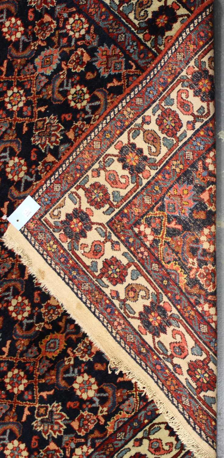 Lot 2901 - A Senneh rug, North-west Persia, early/mid-20th century, the ink blue field with an overall floral