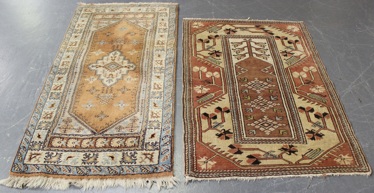 Lot 2918 - A small Turkish rug, mid/late 20th century, the ivory field with an ascending plant, 127cm x 88cm,