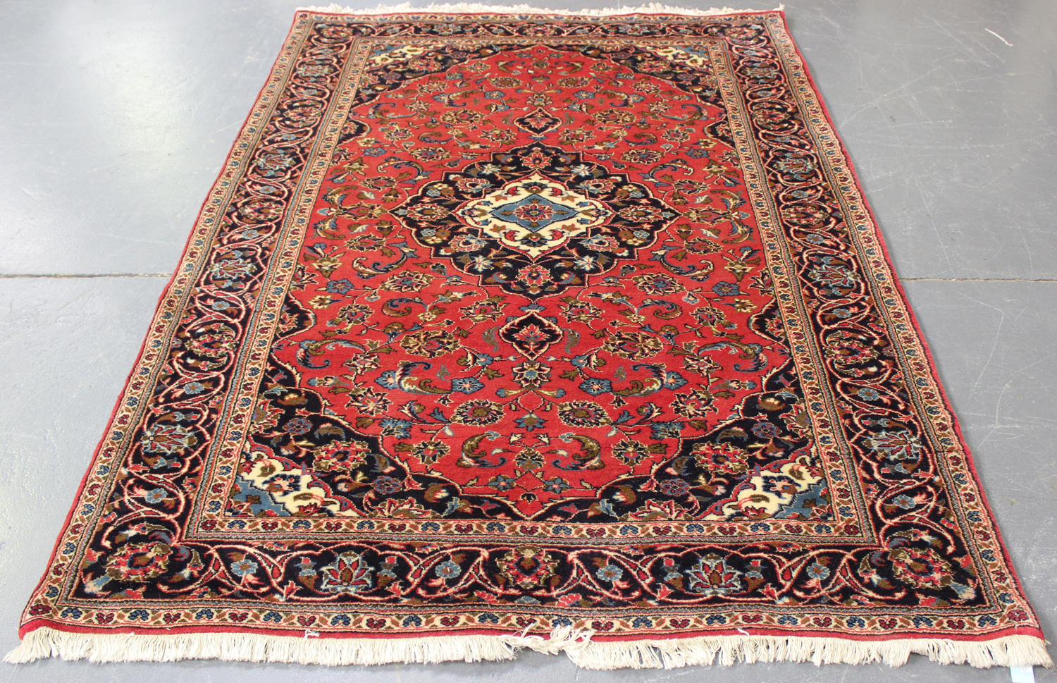 Lot 2919 - A Kashan rug, Central Persia, late 20th century, the red field with a shaped medallion, supported by