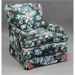 A 20th century Howard style armchair with curved scroll arms, height 88cm, width 79cm.Buyer's