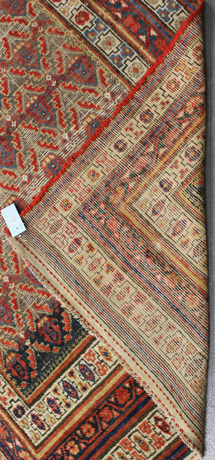 Lot 2912 - A long Hamadan rug, North-west Persia, early 20th century, the blue field with overall offset rows