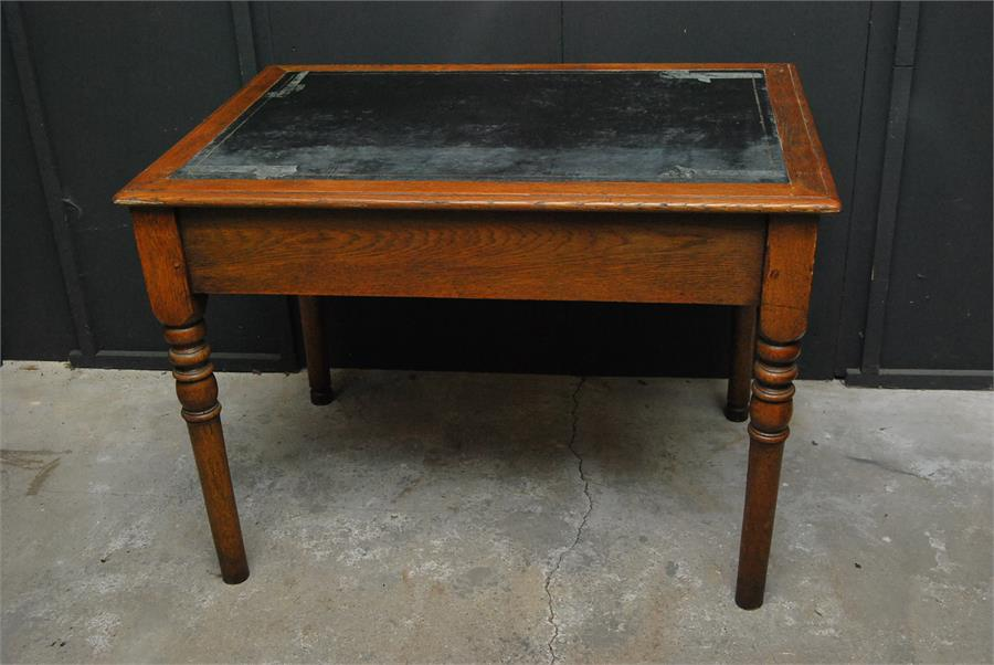 Lot 86 - A two drawer oak writing table late 19th / early 20th century