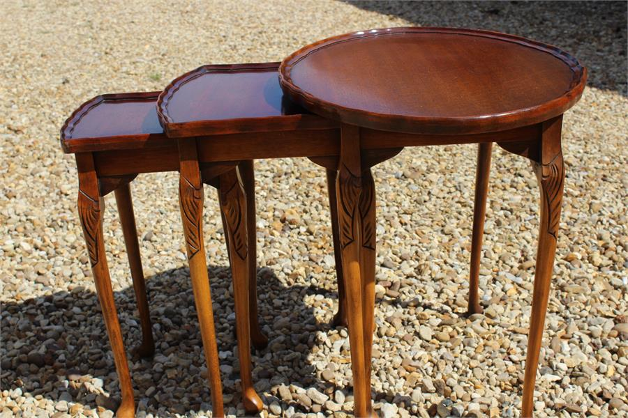 Lot 76 - Modern nest of three oval tables.