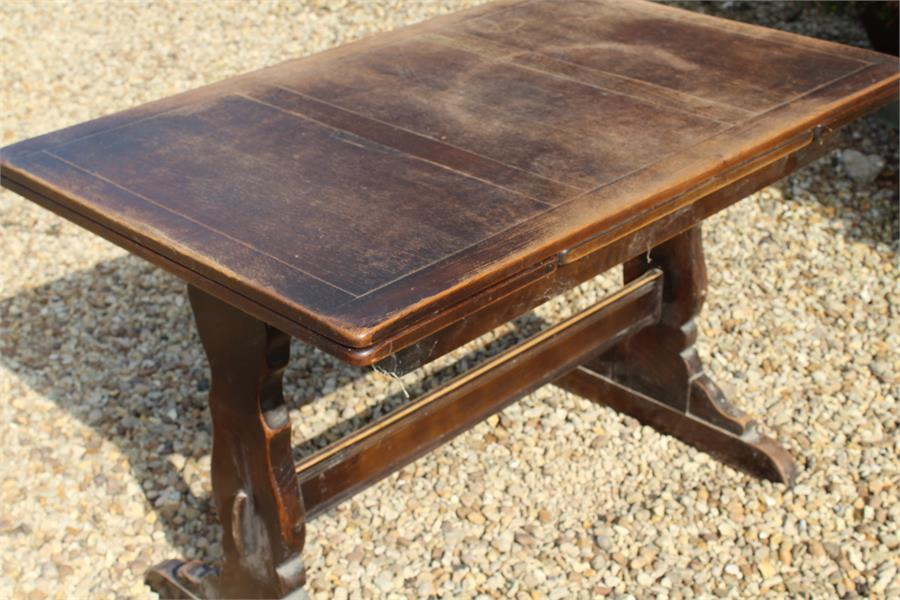 Lot 52 - An Ercol style drawer leaf table