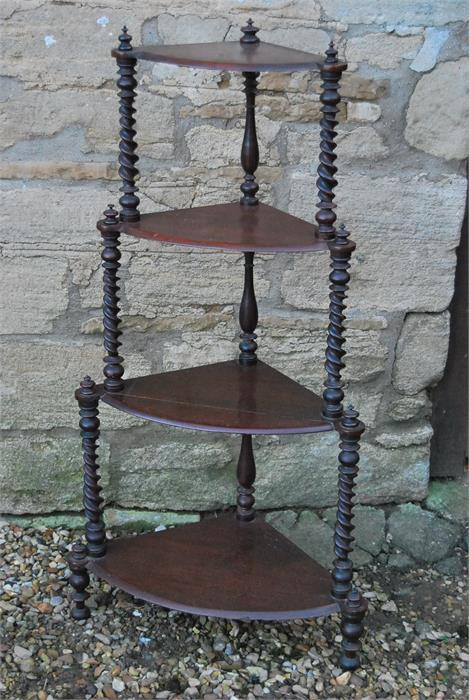 Lot 96 - A four tier wot-not with barley twist supports