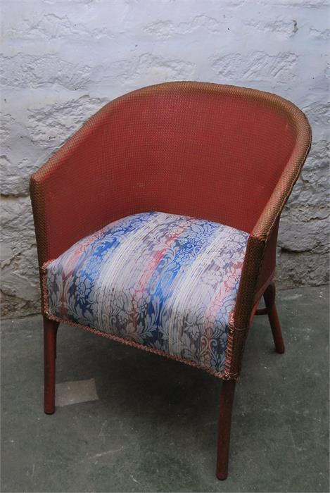 Lot 101 - Lloyd loom style pink chair.