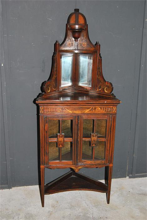 Lot 78 - A 19th century inlaid rosewood glazed and mirrored corner display cupboard with painted decoration.
