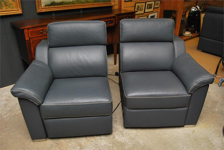 Lot 51 - Two Granfort leather sofas with motors for reclining. PAT tested Dimensions; 156cm by 95cm by 96cm