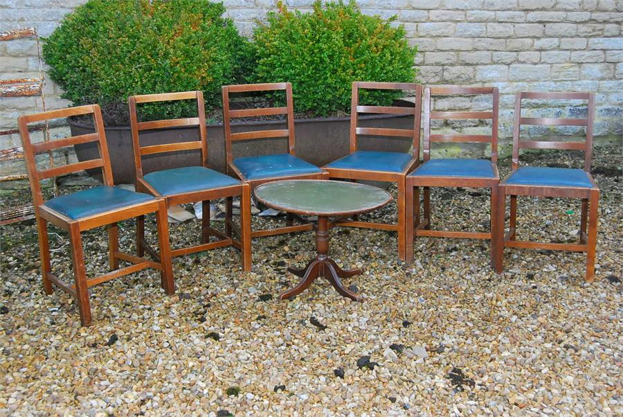 Lot 62 - Six chairs with green cushions and a folding table