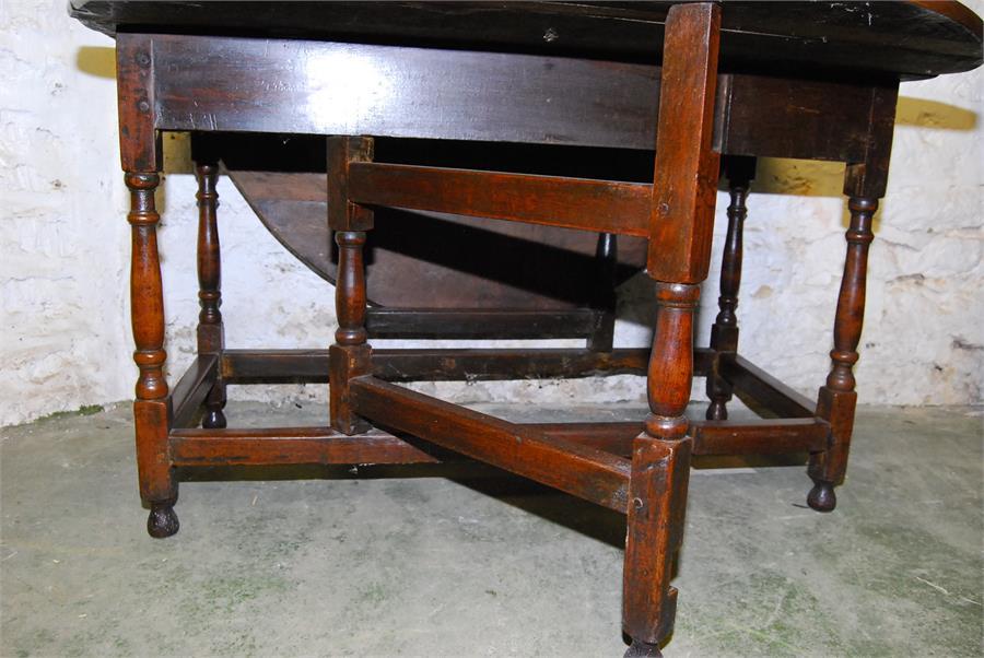 Lot 79 - Oak gateleg oval table - 18th century elements - six seater.