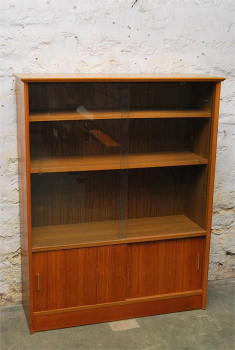 Lot 111 - Herbert Gibbs bookcase with glass sliding doors