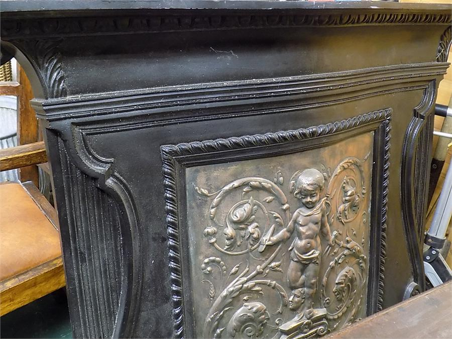 Lot 1 - Cast Iron and Copper Putti relief Overmantel