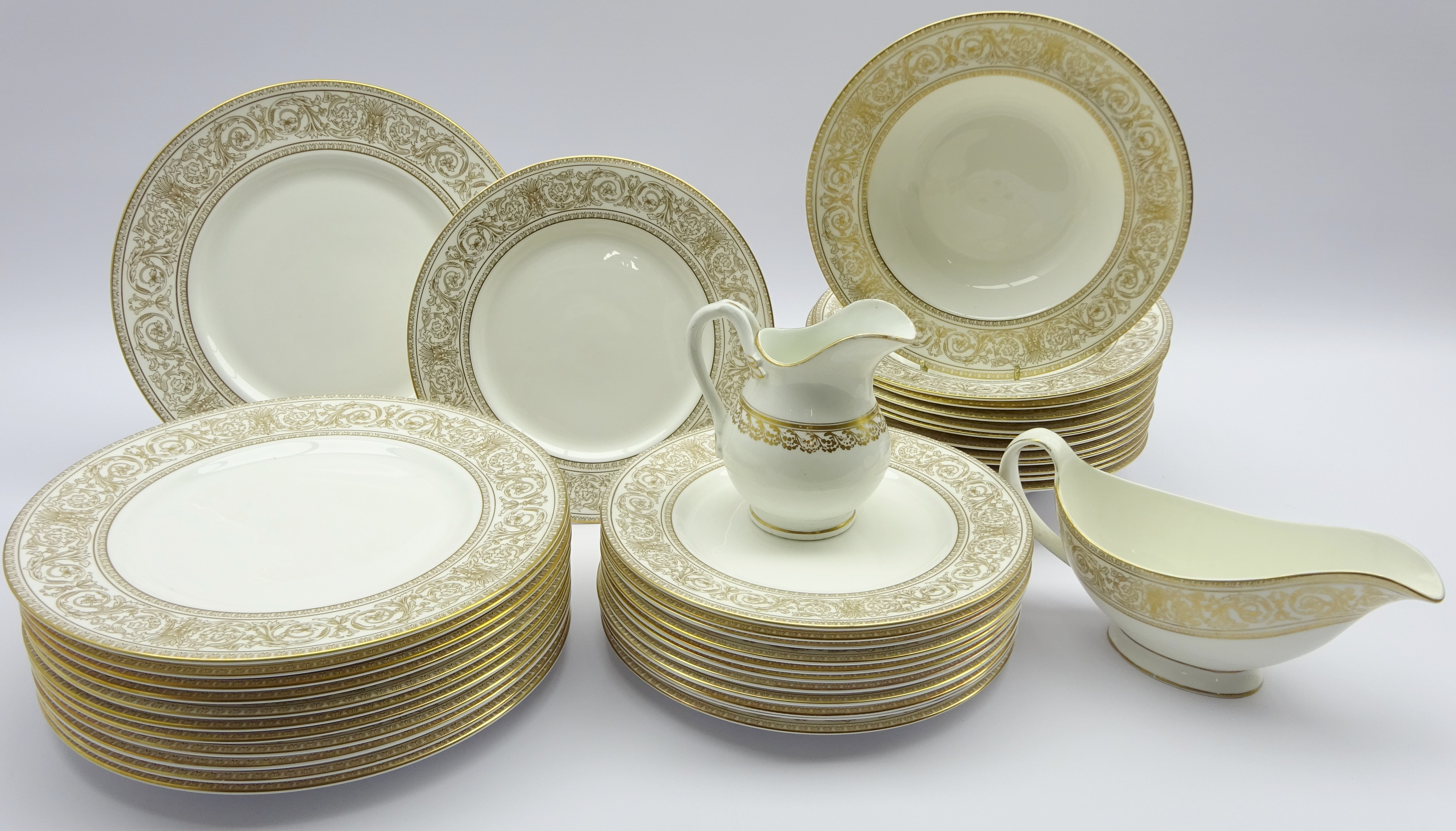 Lot 46 - Royal Doulton 'Sovereign' pattern dinner service comprising twelve dinner plates,