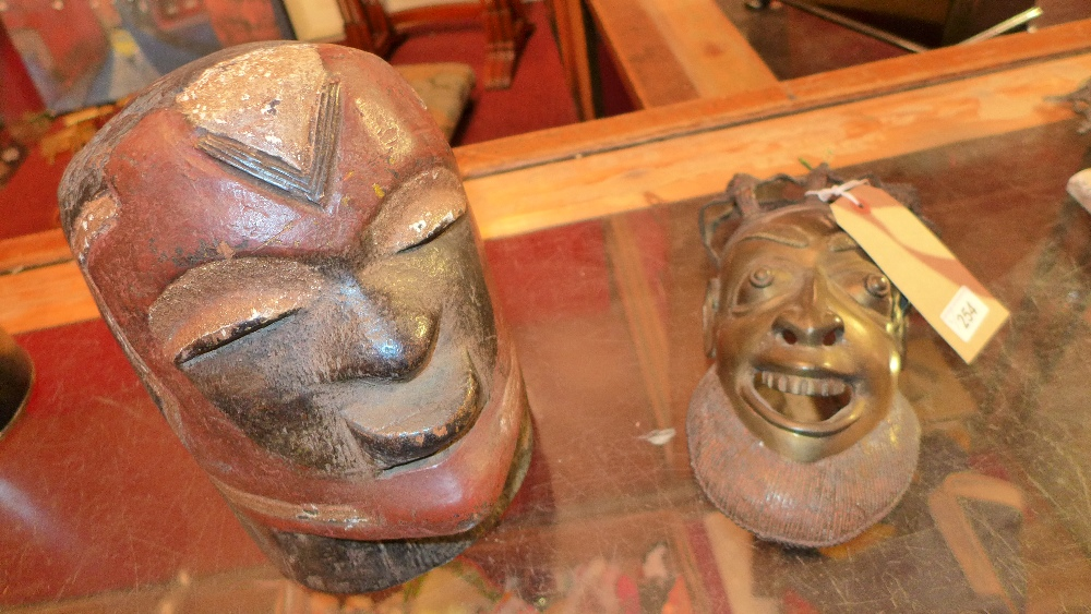 Lot 254 - A Benin style bronze mask and an African