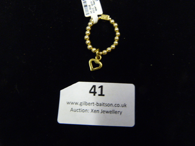 Lot 41 - *Mini Gold Charm Ring