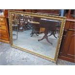 LARGE GILDED AND BEVELLED WALL MIRROR,