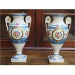 PAIR OF COALPORT STYLE HANDPAINTED, GILDED AND FLORAL DECORATED TWO HANDLED CERAMIC VASES,