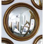 BUTLERS MIRROR, Regency style with gilded surround, 82cm diam.