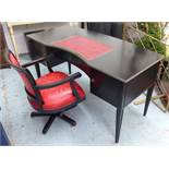 OKA ROUSSEAU DESK, of curved form, black with inlaid red leather writing surface, 153cm W x 69cm D,