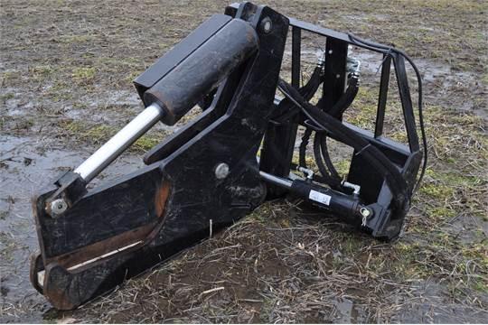 "Skid loader tree shear, 14"" capacity"