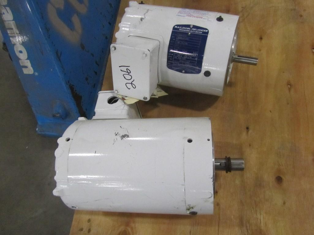 Lot 2061 - (2) New Baldor electric washdown motors, 1 hp and 1.5 hp. (See photos for additional specs). **Riggi