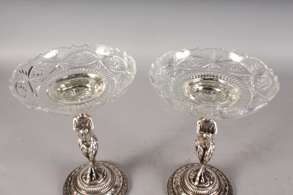 Lot 1059 - A GOOD PAIR OF CUT GLASS AND SILVER PLATED BONBON DISHES.