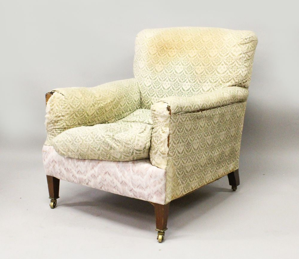 Lot 1024 - A MAHOGANY ARMCHAIR by HOWARD & SONS, 'DUTTON', EARLY 20TH CENTURY, the sides and back cushions