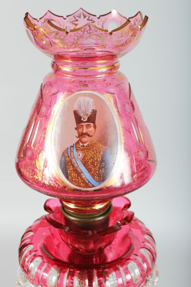 Lot 1062 - A SUPERB LARGE PAIR OF VICTORIAN BOHEMIAN RUBY GLASS LUSTRES, the domes gilded and painted with