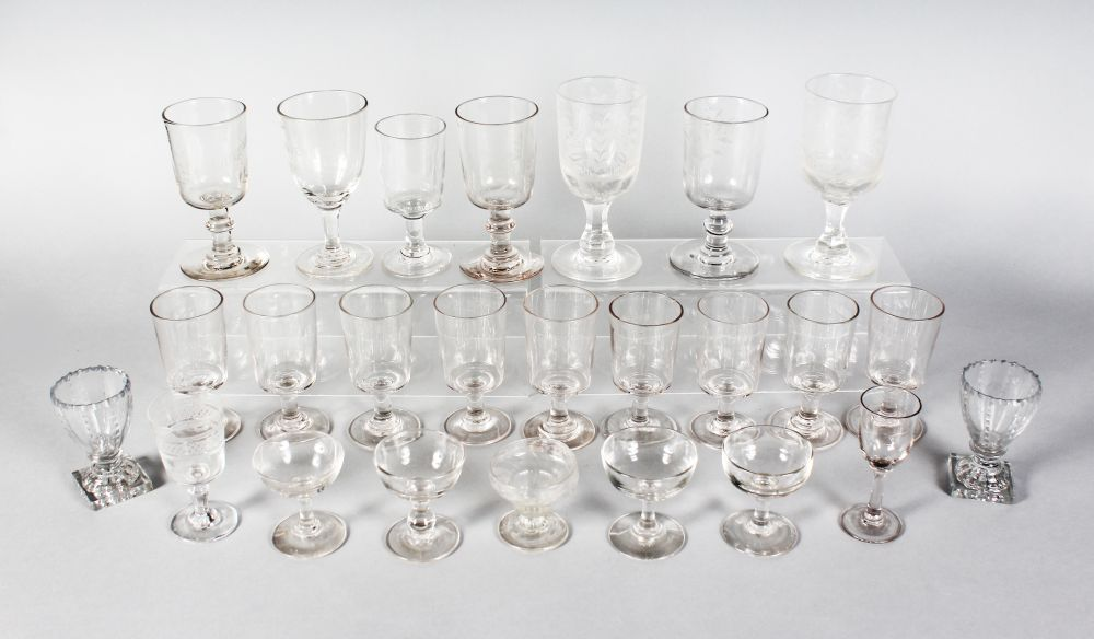 Lot 1056 - A QUANTITY OF TWENTY-FIVE WINE GLASSES, some plain and some engraved.