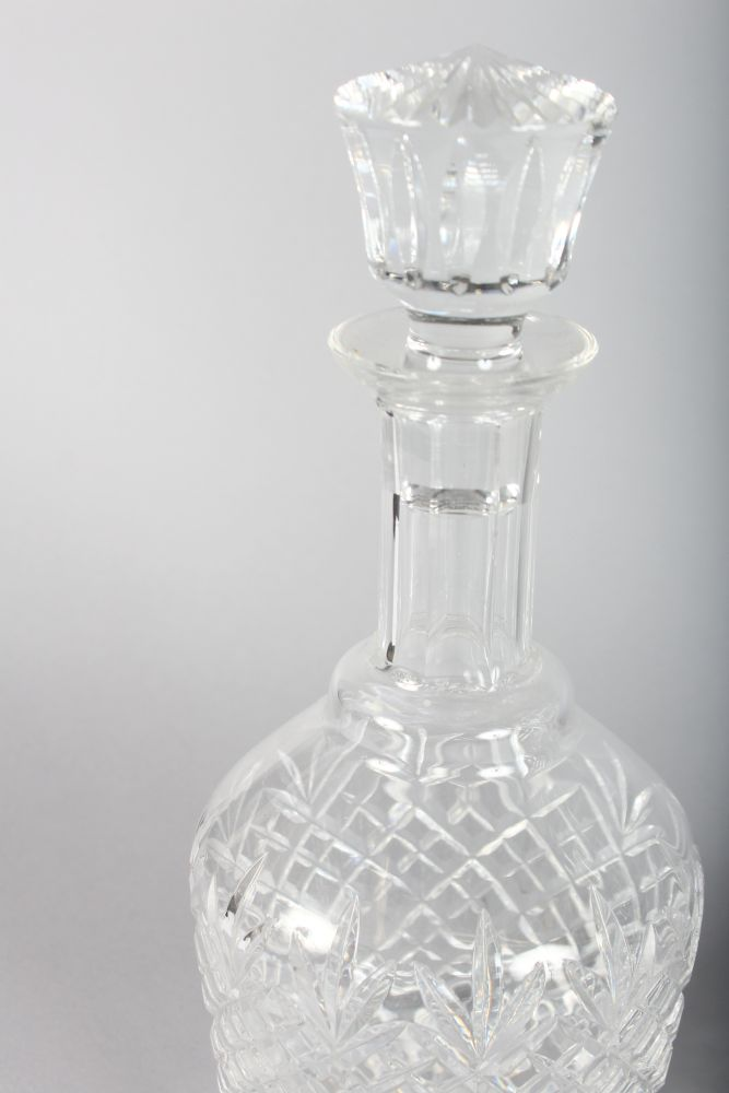 Lot 1031 - A GOOD SET OF FOUR STUART CUT MALLET DECANTERS AND STOPPERS.