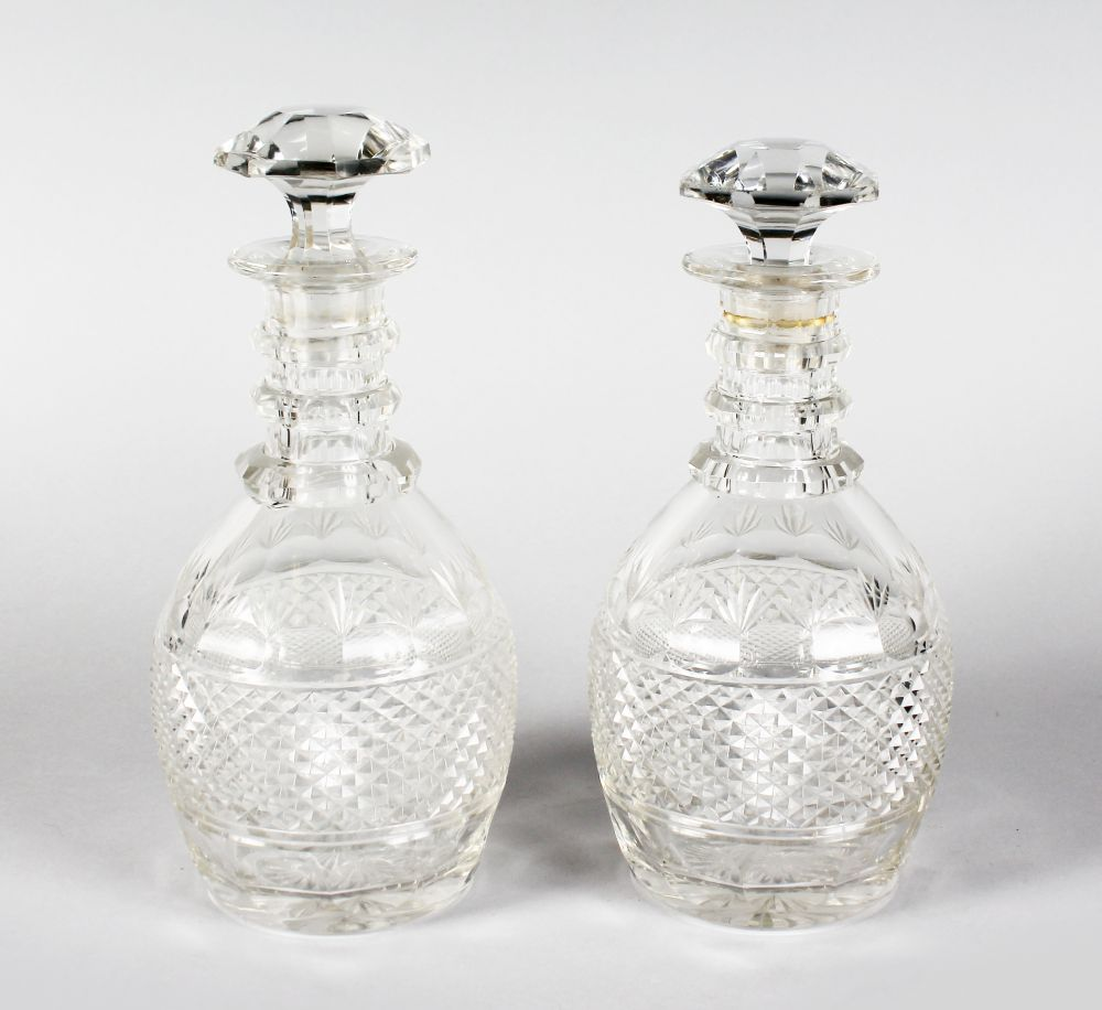 Lot 1035 - A GOOD PAIR OF HOBNAIL CUT DECANTERS AND STOPPERS.