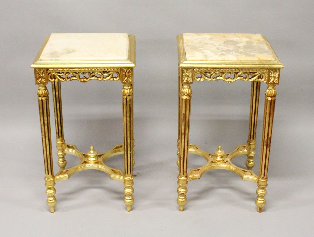 Lot 1014 - A PAIR OF DECORATIVE MARBLE TOP GILTWOOD TABLES, with carved decoration. 2ft 4ins high x 1ft 4ins