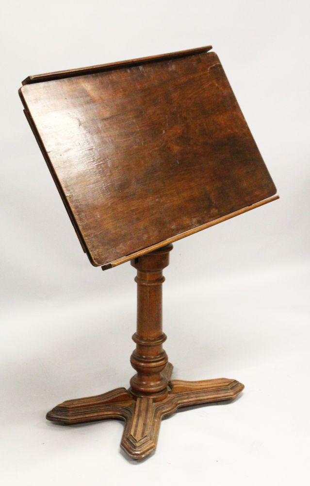 Lot 1007 - A 19TH CENTURY FRENCH MAHOGANY ADJUSTABLE READING TABLE, with tilting and rising top, on a turned