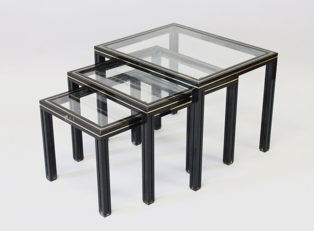 Lot 1003 - A NEST OF FRENCH VINTAGE TABLES by PIERRE VANDEL, CIRCA. 1970'S, in black lacquered metal with glass