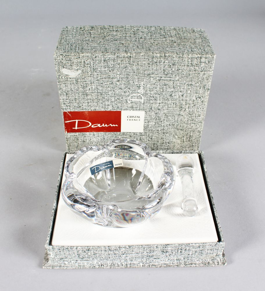 Lot 1058 - A BOXED DAUM PLAIN GLASS PESTLE AND MORTAR.