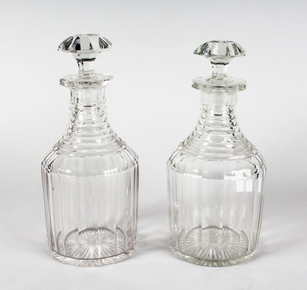 Lot 1033 - A GOOD PAIR OF SQUARE CUT DECANTER`S AND STOPPERS.