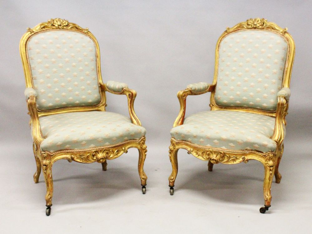 Lot 1020 - A GOOD PAIR OF 19TH CENTURY FRENCH CARVED AND GILDED FAUTEUIL, upholstered in a pale green classical