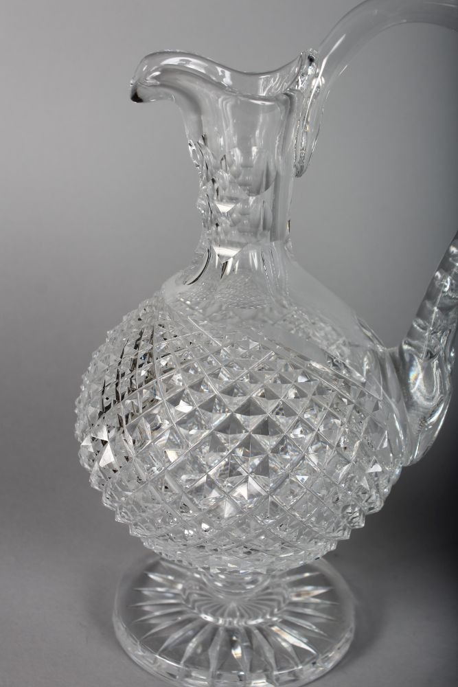 Lot 1032 - A GOOD PAIR OF WATERFORD HOBNAIL CUT CLARET JUGS.
