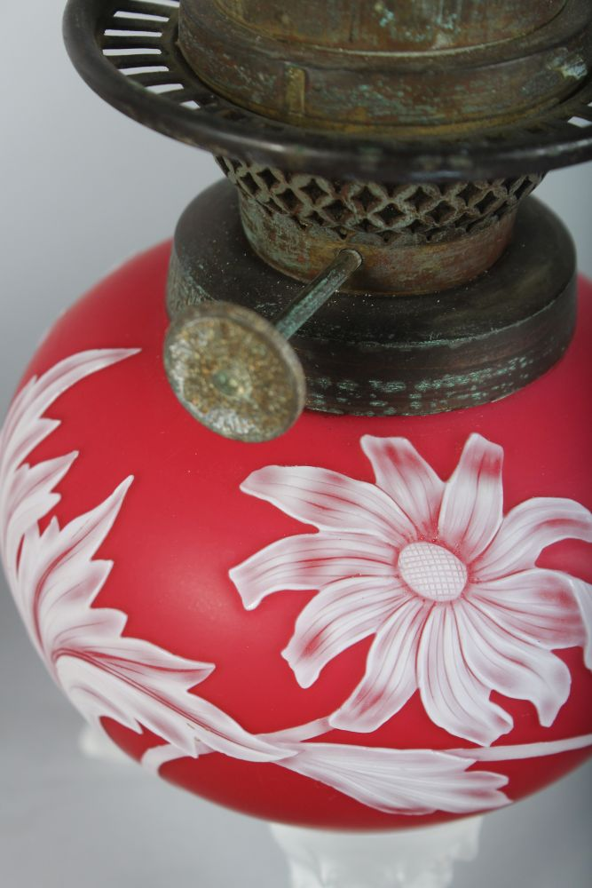 """Lot 1045 - A SUPERB PAIR OF """"WEBBS"""" STYLE RUBY CAMEO OIL LAMP BASES with flowers, thistles and leaves, each"""