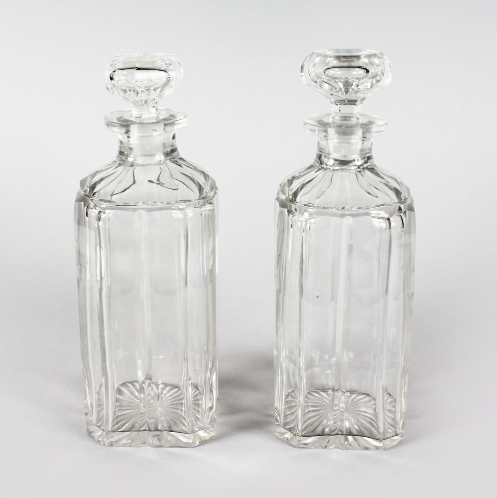 Lot 1034 - A GOOD PAIR OF SQUARE CUT DECANTER`S AND STOPPERS.